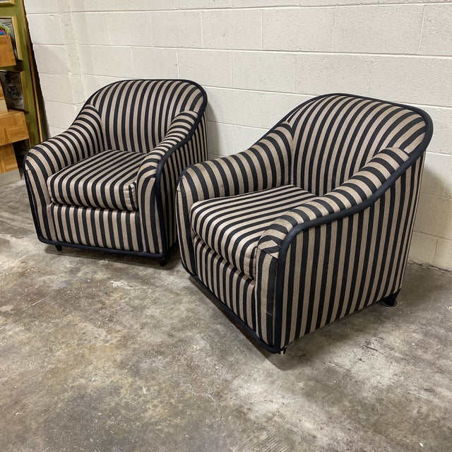 I think these have a great look. Reminds me of a Fendi bag. Black and goldish tan striped woven upholstery. Fabric is in...