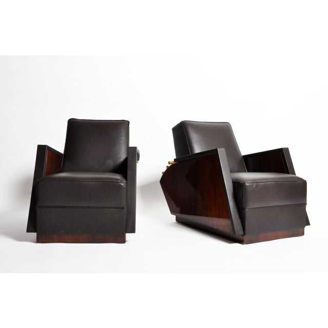 This pair of handsome leather armchairs are from Italy and was made from leather, brass, and walnut, circa 1960. The...