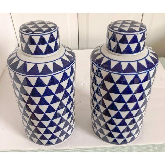 """Handsome pair of blue and white geometric ginger jars with lids. Each, 5.5"""" round x 12""""H."""