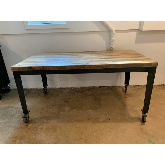 This is a beautiful table made from different types of reclaimed wood but finished with a smooth top. Perfect for an...