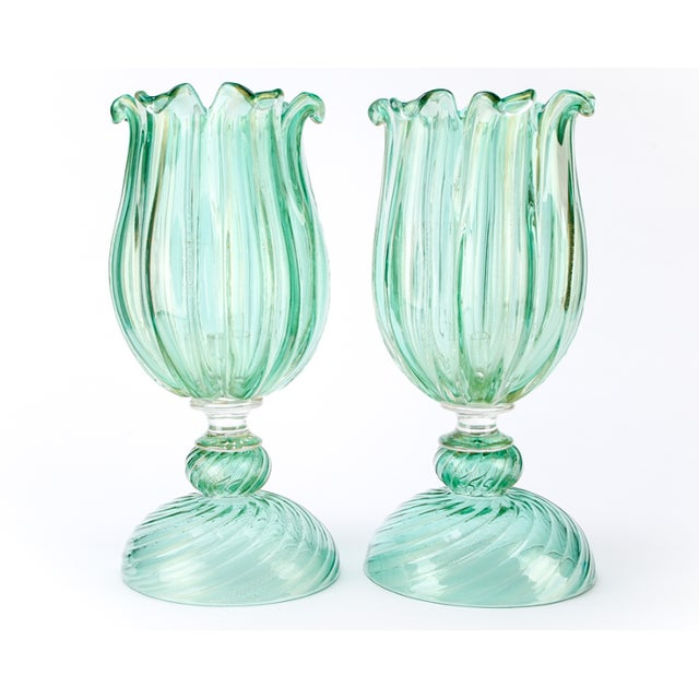 Two Archimede Seguso Murano two-piece votives comprised of a swirled domed base with candleholder and a tulip form shade....