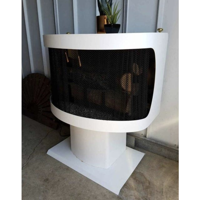 Vintage free standing fireplace by Mastercraft in white. It comes with a vintage artificial log that lights up and rotates...