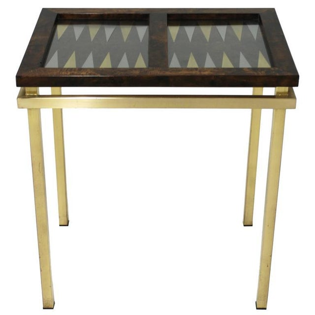 Mid-Century Modern / Deco style burl wood frame amid gold brass base. Featuring tabletop displaying the backgammon board....