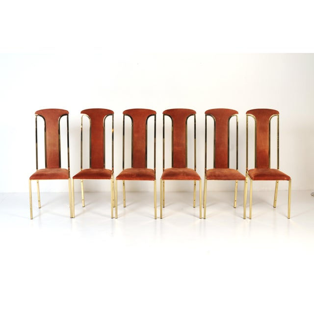 Slim and sexy armless chairs made in Italy. The seats and t-shaped backs are upholstered in a rich rust suede. The thin...
