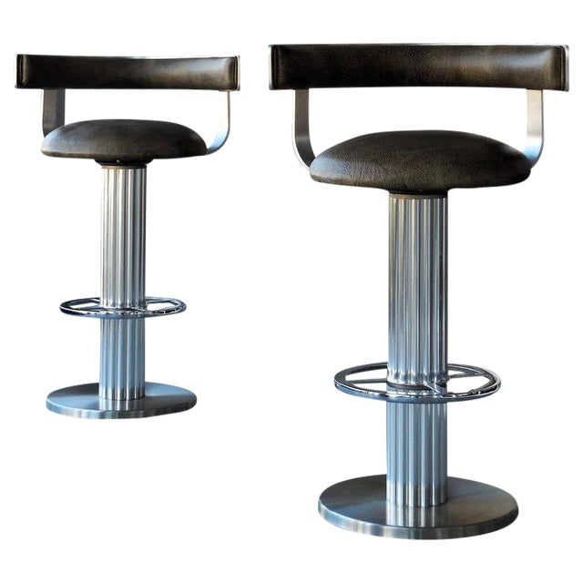 A Pair of Design For Leisure Swivel Leather Bar Stools For Sale