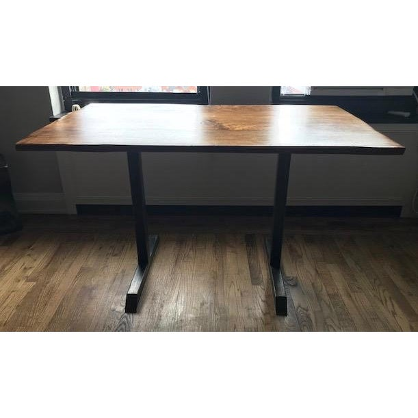 Custom live edge American black walnut table with blackened steel pedestal base. A modern contemporary table that includes...