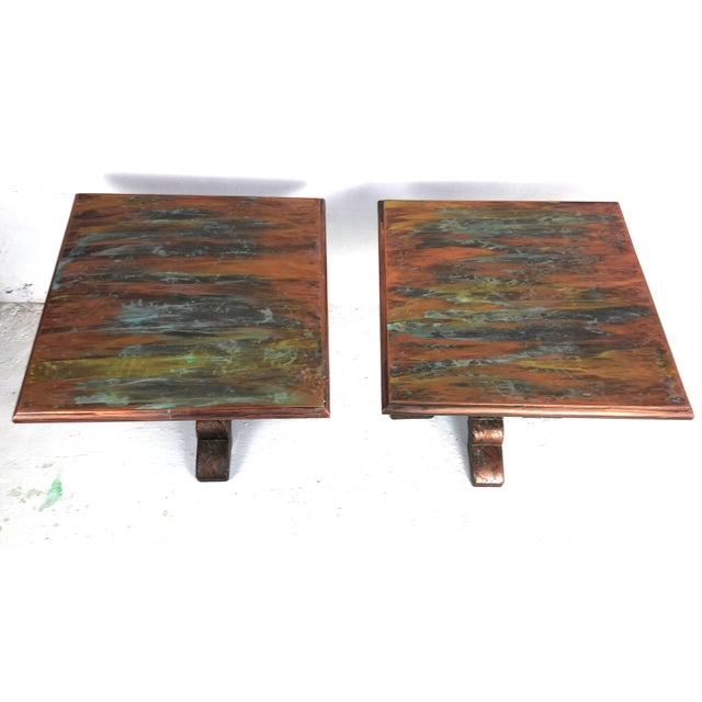 This gorgeous pair of metal mid-century end tables has been refinished in oxidized copper (top) and oxidized bronze (base)...