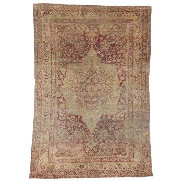 This highly desirable 19th century Turkish Hereke features an intricate center medallion with an idyllic palette...