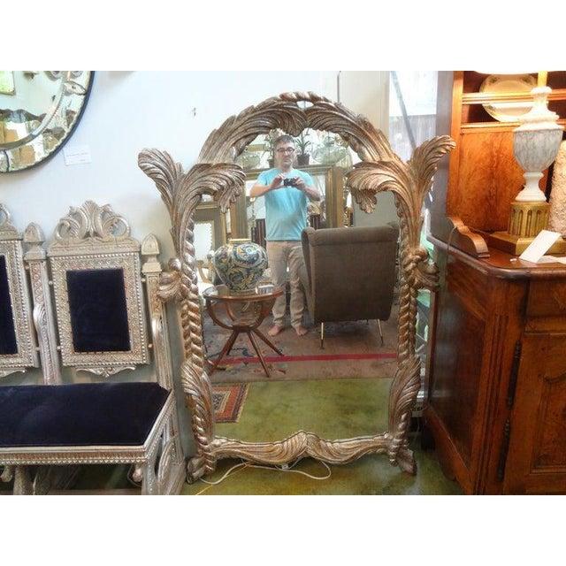 Stunning large Italian mid-century carved wood silver leaf mirror. This beautiful Italian Hollywood Regency silver gilt...