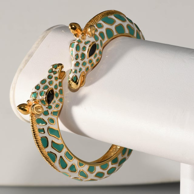 Kenneth Jay Lane turquoise blue and white hinged bangle giraffe bracelet. Metal is gold plated. Spring hinge with no...