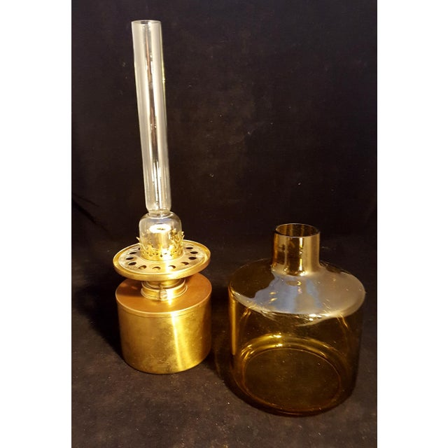 This is a Mid Century Hans Agne Jakobsson Modernist Swedish oil lamp with clear chimney and amber shade. It is in...