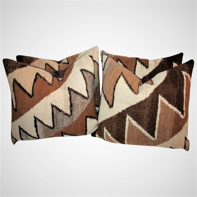 This group of handwoven saw tooth pattern pillows have dark chocolate cotton linen backings. There are two different...