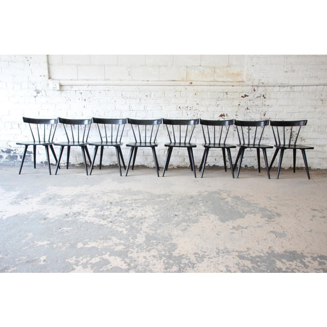 A gorgeous set of eight ebonized mid-century modern spindle back dining chairs from the Planner Group line designed by...