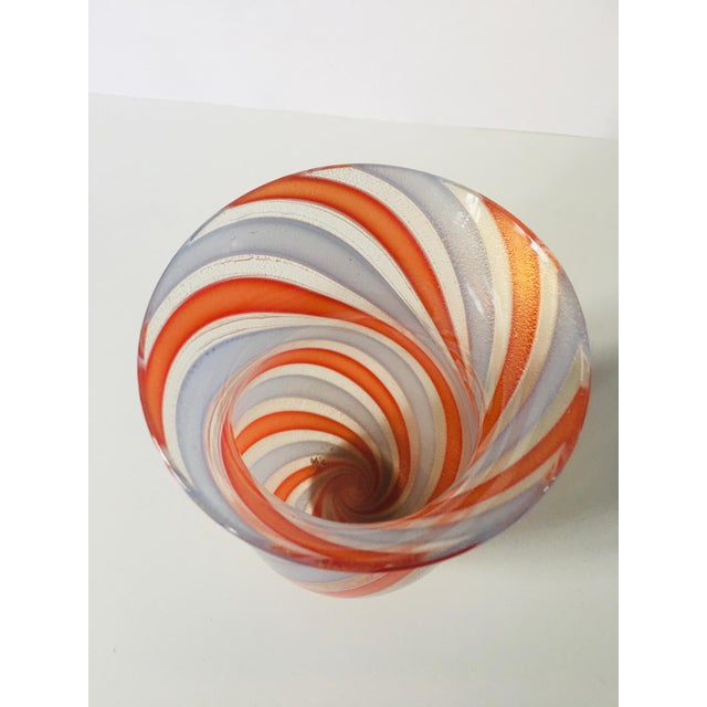 "A ""Zanfirico"" Murano glass vase from Venini with an interlayer decoration of red-orange and blue-white twists and gold..."