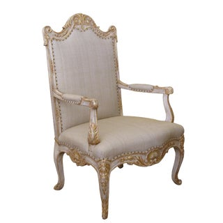 A Baronial French Regence Style Ivory Painted Open Armchair For Sale