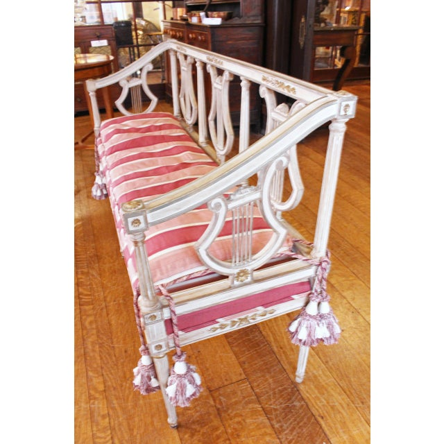 Triple lyre back settee, c. 1900. Continental in the neoclassical taste. Repainted. Provenance: Otto Zenke for a NC...