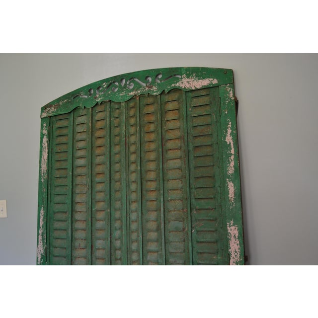 This exquisite, authentic, antique, green iron window shutter with its frame is completely functional. The sections, each...