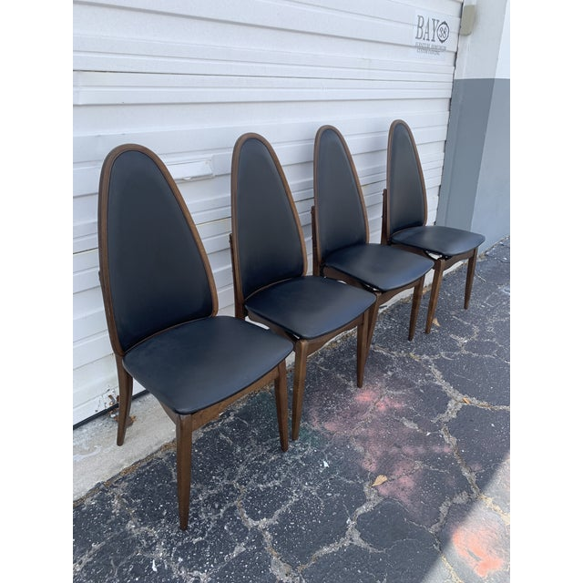 Mid century exaggerated back, black vinyl Stakmore folding chairs and table also covered in black vinyl. Perfect for any...