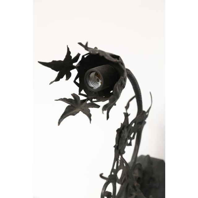 Forged single iron sconce in the manner of Gilbert Poillerat. Incredibly detailed fine quality iron sconce. Neogothic in...