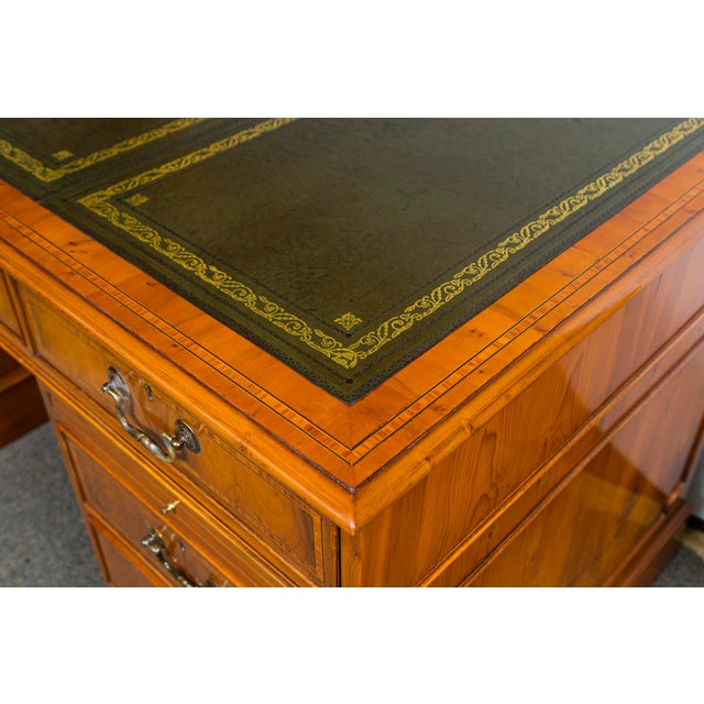 """English Yewood kneehole executive desk, green leather top. 25"""" wide kneehole opening. Drop front computer drawer. Two file..."""