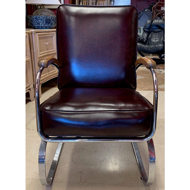 Vintage, Mid Century Modern spring lounge chair. This chrome, stationary rocking chair is in the style of the KEM Weber...