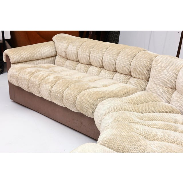 """The three pieces to form an """"L"""" shaped sofa with a radius, the upholstery tufted ad the base in leather could use fabric..."""