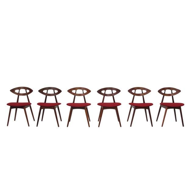 "Mid-century Danish ""Eye"" chairs designed by Ejvind A Johansson for Ivan Gern Mobelfabrik, Denmark. Model #84 features a..."