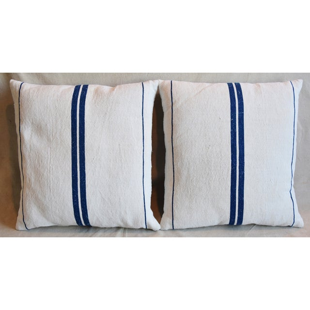 Pair of custom-tailored pillows made from vintage French homespun grain-sack fabric with woven blue stripes. New bone-...