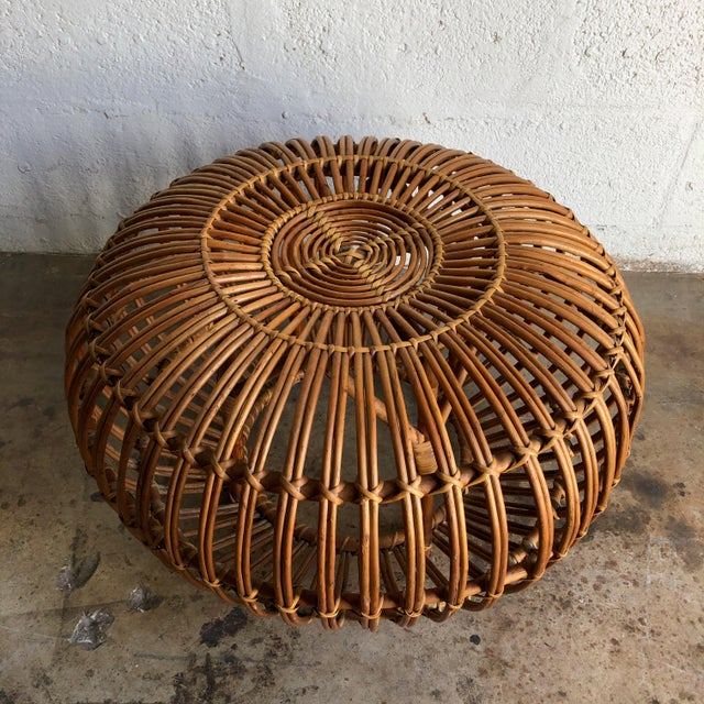 Iconic Vintage Mid-20th century woven rattan ottoman, pouf or stool designed by Franco Albini. This Iconic Mid Century...