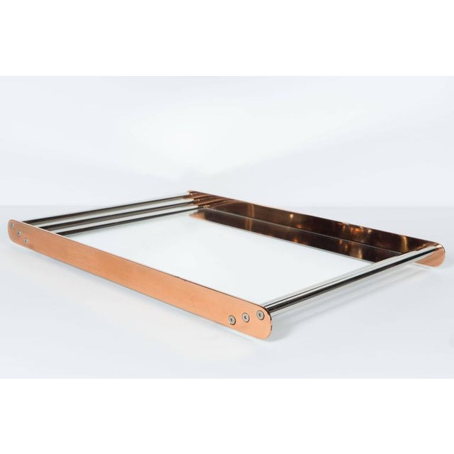 An Art Deco Machine Age skyscraper style mirror-based tray made of copper and chrome. Rounded polished copper sides encase...