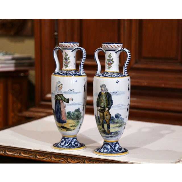 Decorate a mantel or table with this colorful pair of antique faience vases from Brittany, France, circa 1880. Both hand-...