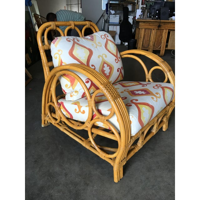 "This rattan ""Circles and Speed"" three strand side arm lounge chair has a matching rattan ottoman. Inspired by Paul Frankl,..."