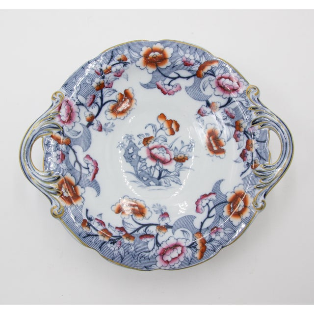 A lovely antique 19th-Century English porcelain compote decorated in the classic Imari style and colors. Maker's mark on...