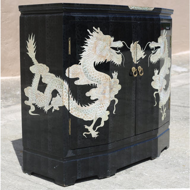 Asian Vintage Chinoiserie Black Lacquered Cabinet With Carved Dragons For Sale - Image 3 of 12