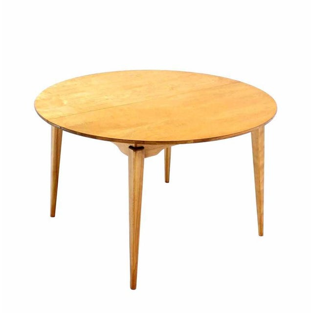 "Possibly Risom design round birch table 3 x 10"" leaves."