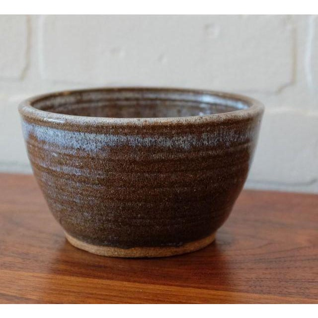 """Vintage studio pottery bowl. Stoneware clay with brown w/milky glaze. Signed """"Alba"""" date unknown."""