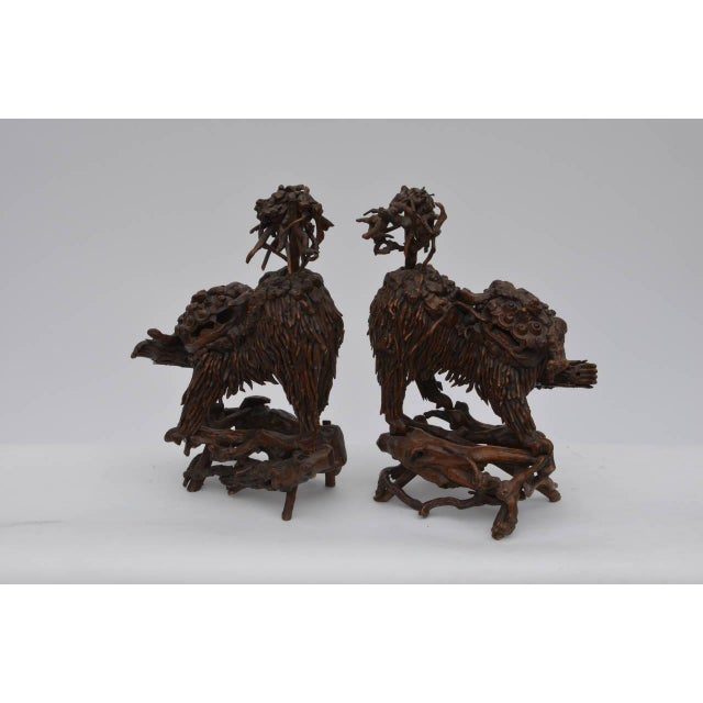 Pair of rare Chinese carved wood foo dogs.