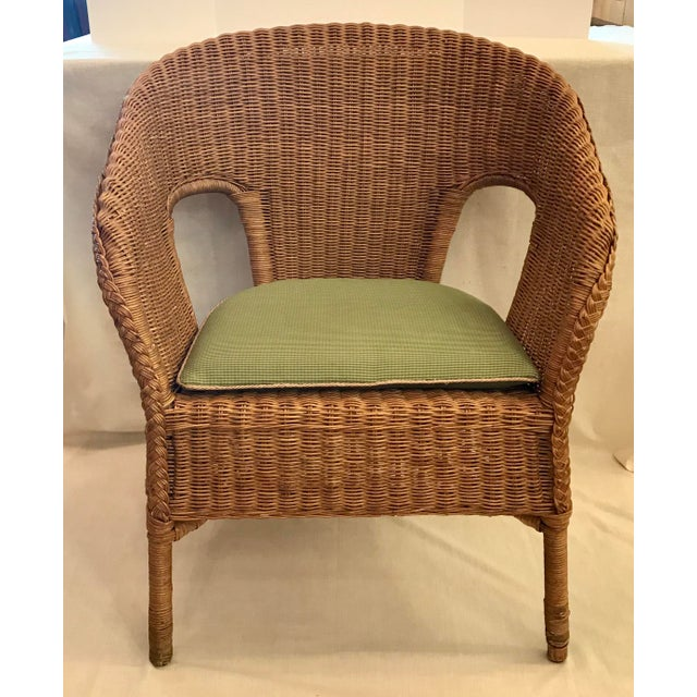 This is a vintage natural wicker chair, with a green cushion. The piece is from the late 20th century. The seat height...