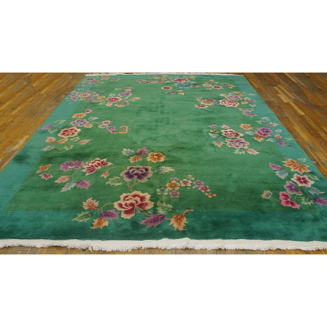 """This is a Chinese art wool rug from China 1920. The size is 8'8""""x11'4"""". The colors are green, purple, red, orange, cream,..."""
