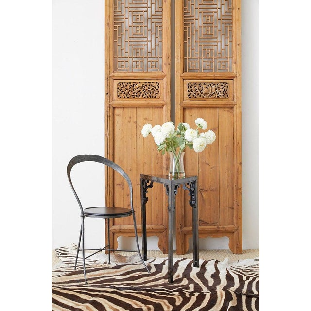Distinctive pair of Chinese carved doors featuring an open fretwork design lattice panel windows. The thick frames have an...