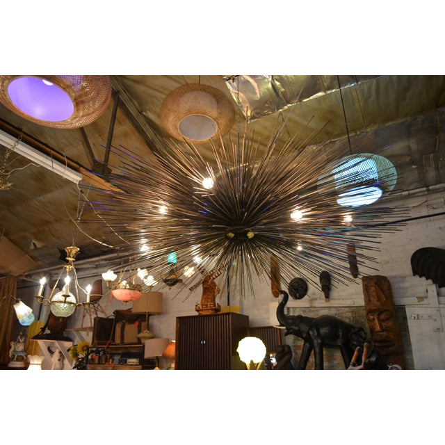 This is the real deal! Gorgeous starburst chandelier extremely well made in a bronze finish. This beauty is large in size...