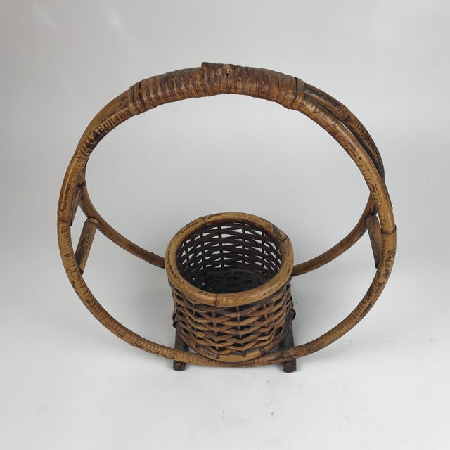 Lovely round circle basket planter can be used hanging or resting on a surface. It no longer retains the loop at the top...