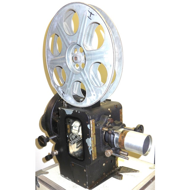 Suggest for your consideration is this 35mm Motion Picture Cinema Projector designed in 1922 and built in 1937. This...