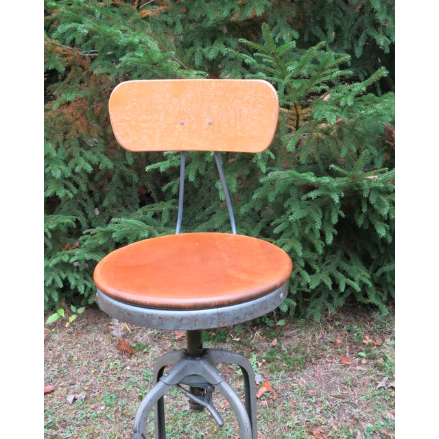 """Vintage Industrial Toledo Stool. The seat can raise from 26"""" to 29.5"""". Good condition with normal wear. Has a silver paint..."""