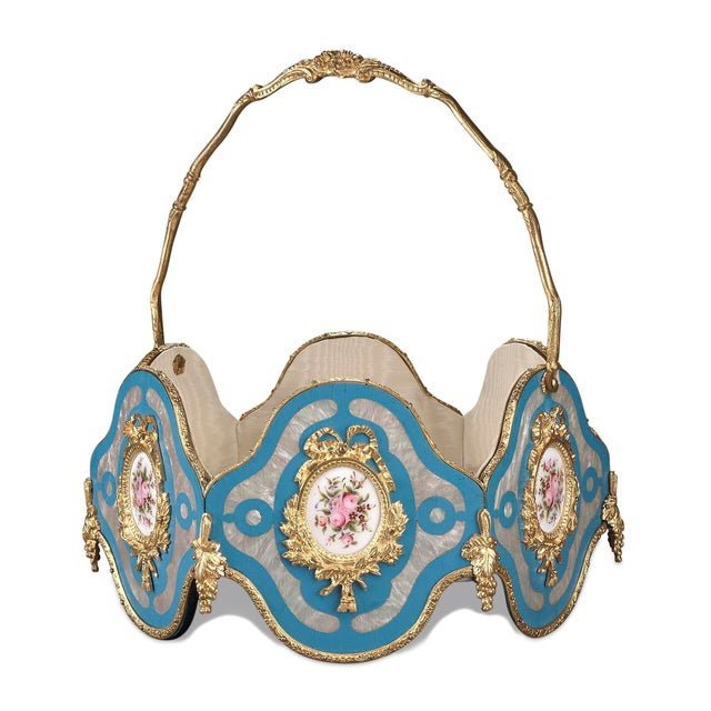 A delightful French basket mounted in doré bronze which provides the framework for the six panels veneered in mother-of-...
