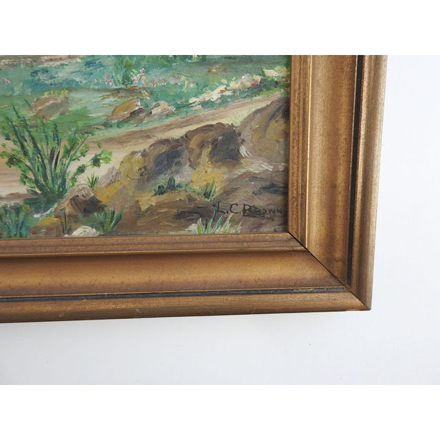 Oil on artist board of mountain landscape. Signed L. C. Brown lower right corner. Displayed in giltwood frame, scuffing to...