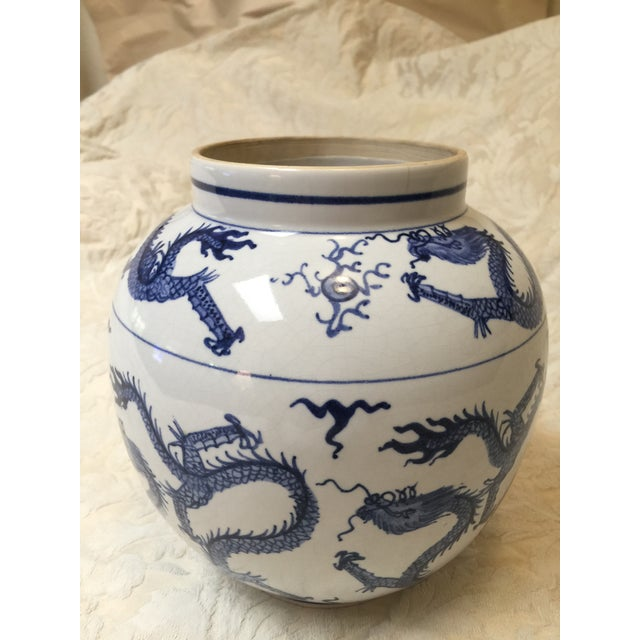 Older Export Chinese Blue and White dragon urn or vase. Wonderful dragons chasing the pearl motifs around whole of vase....