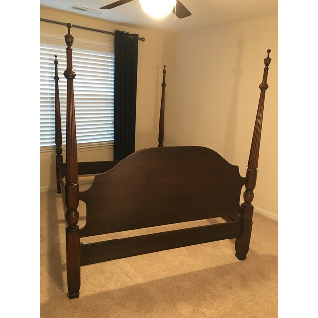 """Harden Furniture solid cherry queen size bed frame in the traditional """"carved rice pattern"""" with brass medallions on the..."""