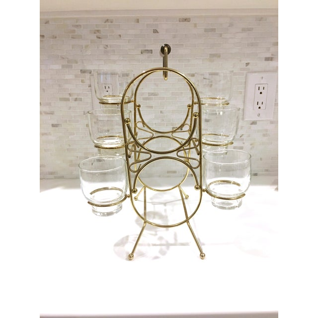 Holds 6 glasses and 2 bottles. The perfect addition to a bar cart! Minor wear as shown in the last photo. The 6 glasses...