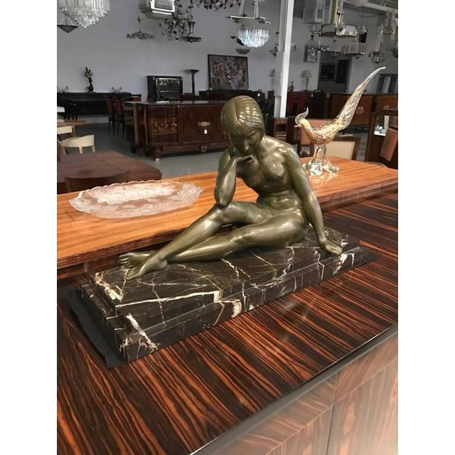 Stunning French Art Deco bronze sculpture of nude seated female signed by J.P. Morante. The bronze is a beautiful green...